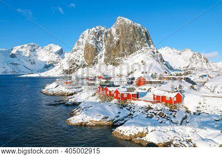 Picturesque Winter View On Hamnoy Village And Festhaeltinden Mountain On Background. Popular Tourist
