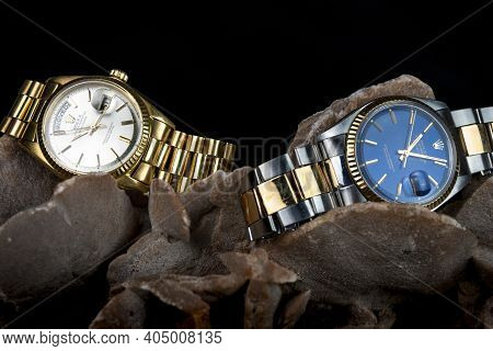 Rolex Oyster Perpetual Day- Date And Oyster Blue Watch On A Desert Rose