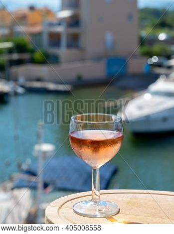 Tasting Of Local Rose Wine In Summer With Sail Boats Haven Of Port Grimaud On Background, Provence,