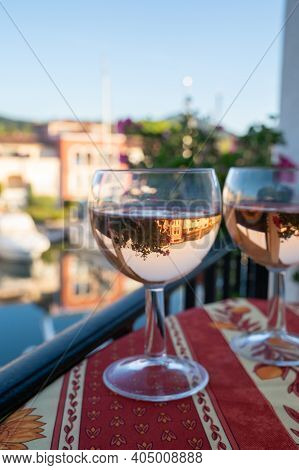 Drinking Of Local Rose Wine In Summer With Sail Boats Haven Of Port Grimaud On Background, Provence,