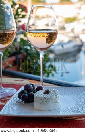 Tasting Of Local Rose Wine And Soft French Goat Cheese In Summer With Sail Boats Haven Of Port Grima