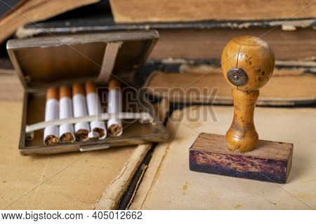 Wooden Stamp For Stamping And Cigarettes In A Metal Cigarette Case. Office Accessories In The Old Of