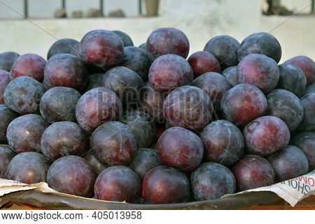 A Closeup Shot Of Violet Plums In A Market Place, Fresh Plums On The Market Place, Ripe Dark Red Plu