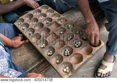 Hands Of Black African People Playing Mancala Game, Dar Es Salaam, Tanzania. Mancala Or Bao Is A Gam