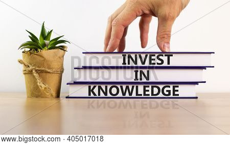 Time To Invest In Knowledge. Books With Text 'invest In Knowledge' On Beautiful White Background. Ho