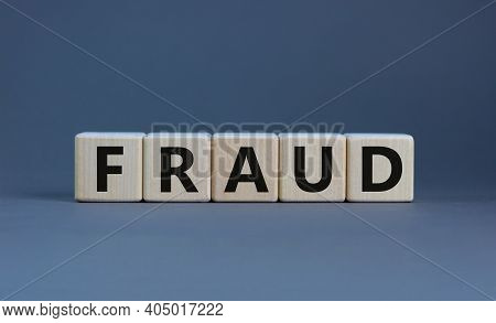 Fraud Symbol. Concept Word 'fraud' On Wooden Cubes On A Beautiful Grey Table. Grey Background. Busin