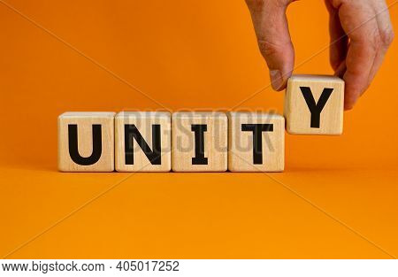 Time To Unity Symbol. Concept Word Unity On Wooden Cubes On A Beautiful Orange Background. Businessm