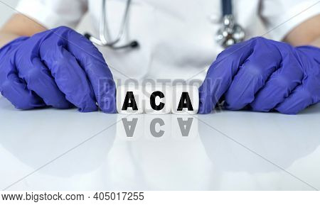 Medicine And Health Concept. The Doctor Put Together A Word From Cubes Aca. Affordable Care Act.