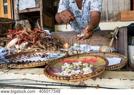 Local African Swahili People Selling Shells From The Ocean On The City Market, Fish Market In Dar Es