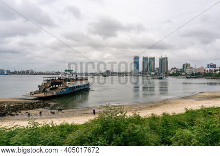Dar Es Salaam, Tanzania - January 2020: Crowd Of African Black People Are Boarding On The Ferry In D