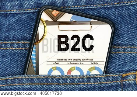 Business And Finance Concept. In A Pocket Of Jeans There Is A Smartphone On The Screen Of Which The