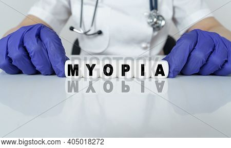 Medicine And Health Concept. The Doctor Put Together A Word From Cubes Myopia
