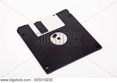 Old Computer And Data Storage Technology, Black Plastic Magnetic Floppy Disk 3½ Inches, Isolated On