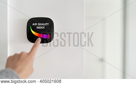 Air quality index showing on smart home domotic tech device. Woman touching touchscreen for clean air breathing purifying filter.