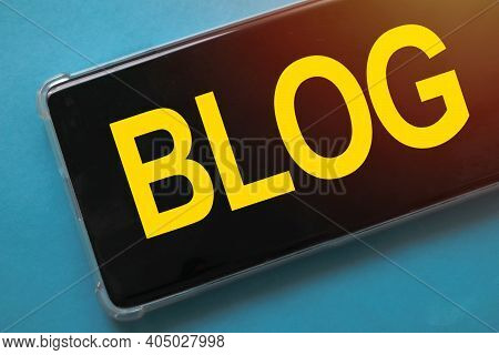 Blog, Text Words Typography Written On Smart Phone Against Blue Background, Life And Business Motiva