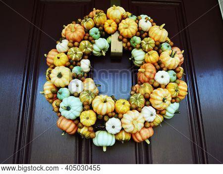 Pumpkin Fall Autumn Wreath On Red Door Background