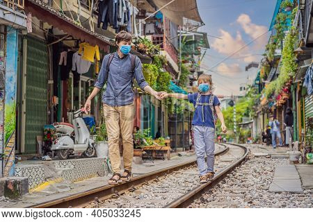 Father And Son Travelers Wearing A Medical Mask During Covid-19 Coronavirus Walk Around Railway Path