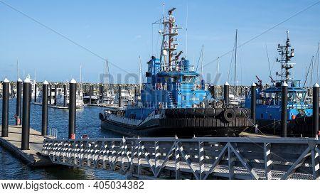 Mackay, Queensland, Australia - February 2021: A Tug Boat Moored At The Marina Port At Mackay
