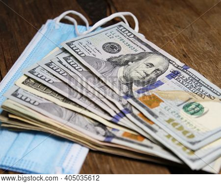 Cash Stimulus Payment With Medical Mask And Sanitizer In Clinical Background.