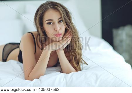Perfect Sexy Tan Woman With Perfect Skin, Big Full Lips Posing At Bedroom, Wearing Sexy Luxury Styli