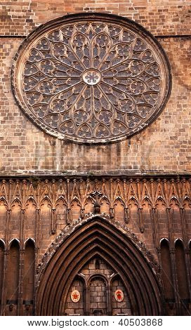 Rose Stained Glass Window Old Stone Basilica St Maria del Pi Saint Mary of Pine Tree in Barcelona Catalonia Spain. Saint Maria del Pi was founded in 987AD or earlier. This is one of the largest rose windows in the World and was created in 1380. poster