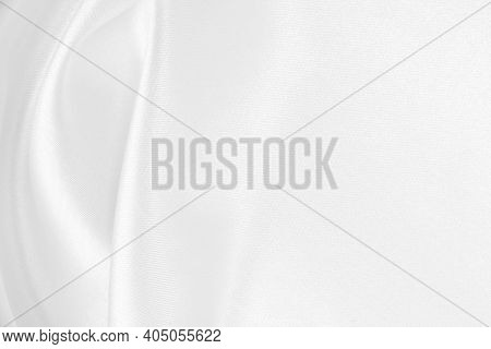 Smooth Elegant White Silk Or Satin Luxury Cloth Texture Can Use As Wedding Background. Luxurious Bac
