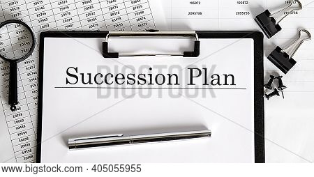 Succession Plan Management Written On The Paper With Office Tools