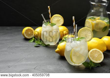 Natural Lemonade With Mint On Grey Table, Space For Text. Summer Refreshing Drink