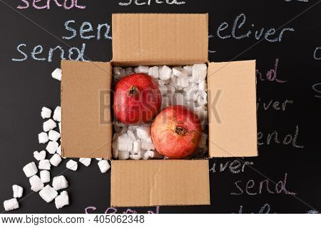 Delivered Pomegranate Fruit In A Delivery Box, Top View.
