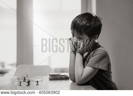 Black And White Emotional Portrait Sad Kid Sitting Alone Looking Out Deep In Thought, Lonely Boy Pla