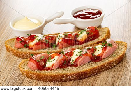 Sauce Boats With Mayonnaise And Ketchup, Sandwiches With Sausage, Mayonnaise And Ketchup On Wooden T