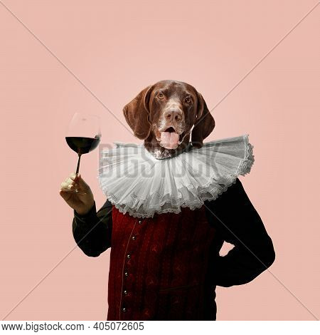Wine. Model Like Medieval Royalty Person In Vintage Clothing Headed By Dog Head On Pink Pastel Backg