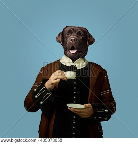Coffee Break. Model Like Medieval Royalty Person In Vintage Clothing Headed By Dog Head On Blue Back