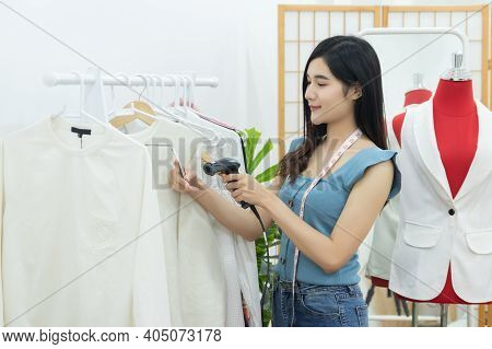 Small Business Owner Concept. Young Happy Confident Designer Asian Woman With Tape Measure On Neck U