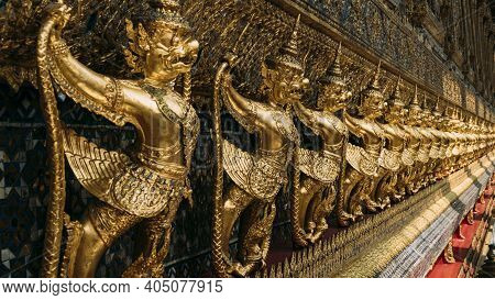 Line Of Ornate, Golden Garuda Statues Hanging On Wall Of The Emerald Buddha Temple, Wat Phra Kaew, G