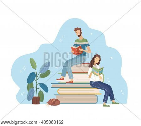 Young Man And Woman Reading While Sitting On Stack Of Big Books. Happy People Relaxing With Book Car