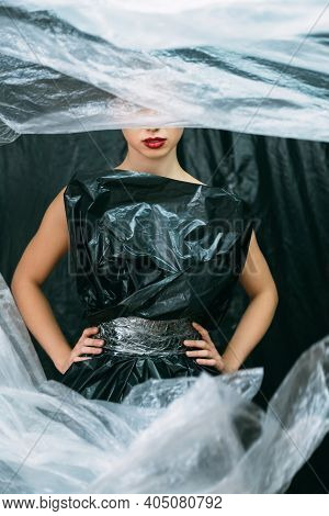Plastic Fashion. Waste Reduction. Nature Conservation. Air Pollution. Female Model With Red Lips Pos