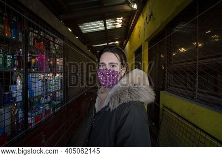 Subotica, Serbia - November 21, 2020: Woman, Standing In The Buvljak, Subotica's Market, Wearing Fac