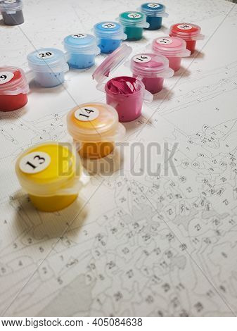 Lots Of Bright Acrylic Paints On Canvas. Drawing By Numbers. Lots Of Bright Acrylic Paints On Canvas