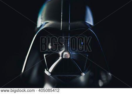 JAN 25 2021: close up portrait of Darth Vader helmet on black background - shallow depth of field