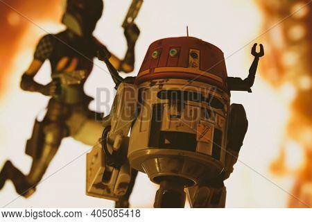 JAN 25 2021: Star Wars Rebels astromech C1-10P droid Chopper and Mandalorian Sabine Wren escaping an explosion  - Hasbro action figure