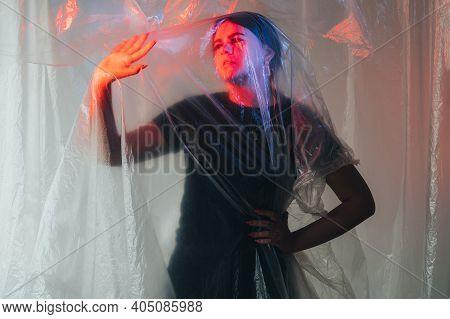 Female Loneliness. Defocused Art Portrait. Self Isolation Melancholy. Depressed Pensive Woman Behind