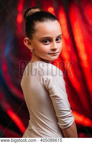 Young Ballerina Portrait. Kid Hobby. Choreography School. Confident Inspired Little Girl In White Bo