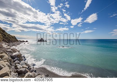Winter Sea. View Of Asseu Rock In Riva Trigoso On Ligurian Coast. Blue Sea Waters Goes Beyond The Ho