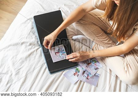 Cropped Woman Hands Holding And Watching A Family Photo Album. Mother Sit On Bed And Watching Album
