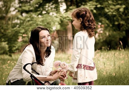 Nostalgy - mother with her child outdoors