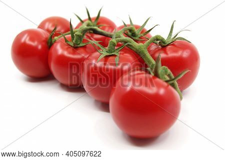 Tomatoes Isolated On A White Background. Red Tomatoes On A Twig On A White Background. Tomato Branch