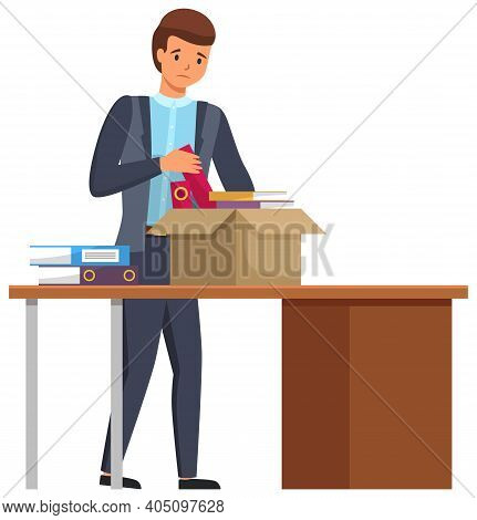 Layoff Concept. Boss Dismissed Employee. Unhappy Fired Man Leaves The Office, Drops Things In A Box.