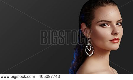 Beautiful Woman Wearing Luxury Fashion Earrings. Diamond Shiny Jewelry With Brilliants. Sexy Retro S
