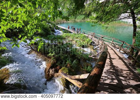 Plitvice, Croatia - June 15, 2019: People Visit Plitvice Lakes National Park (plitvicka Jezera) In C